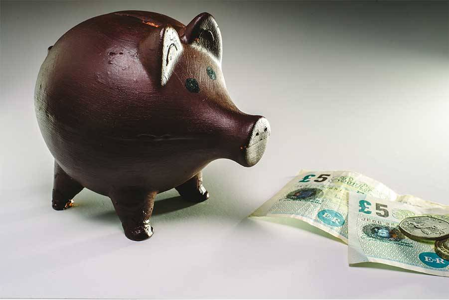 piggy bank with pound notes